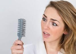 علائم و علت ريزش مو